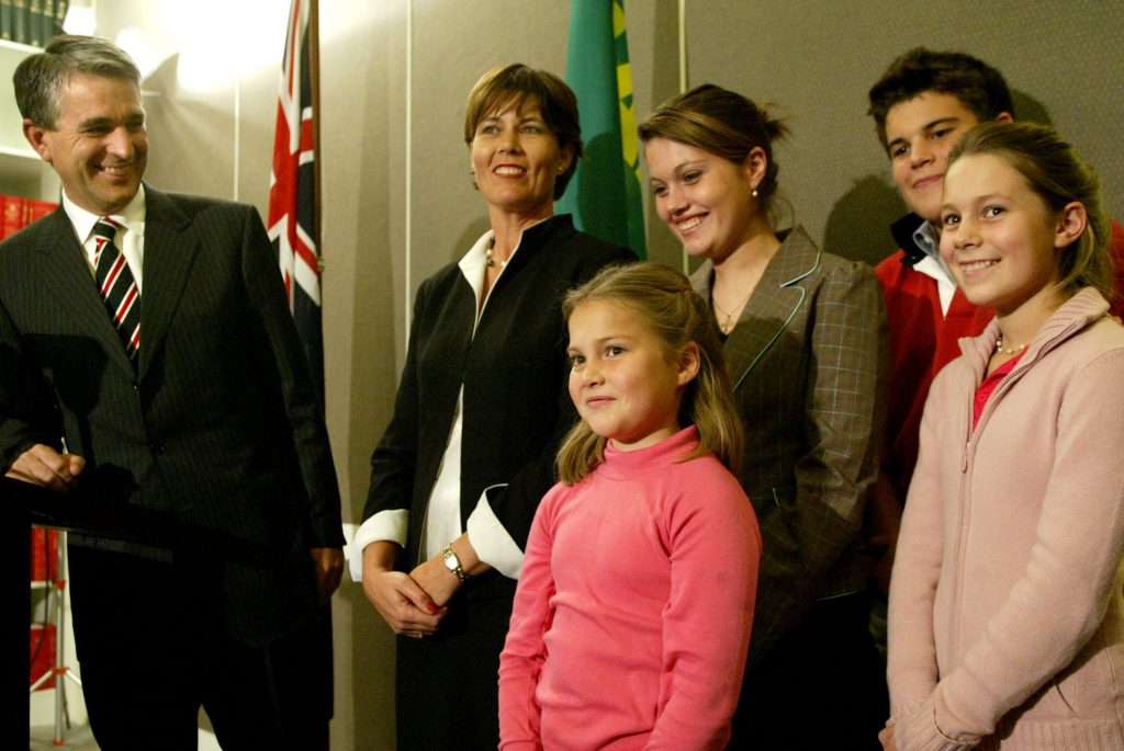 Deputy Prime Minister and leader of the National Party John Anderson with his wife Julia, eldest daughter Jessica 17, son Nick 15, daughter Georgina and youngest daughter Laura at a press conference to announce that he is stepping down from his positions for health reasons and to be with his family. Photographed at Parliament House, Canberra, 23 June 2005. SMH NEWS Picture by PENNY BRADFIELD
